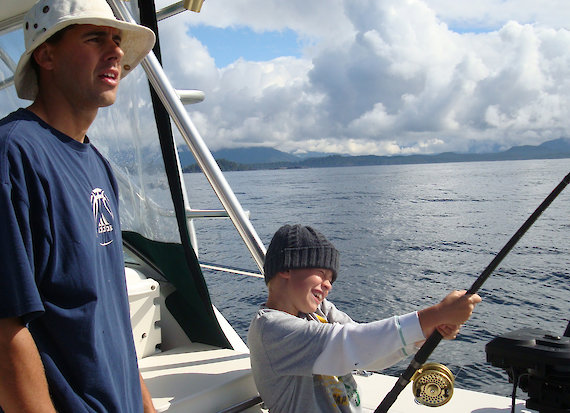 Boy fishing with guide near Tofino Canada